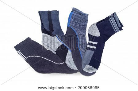 Several pairs of the different men's thermal socks and crew socks on a white background