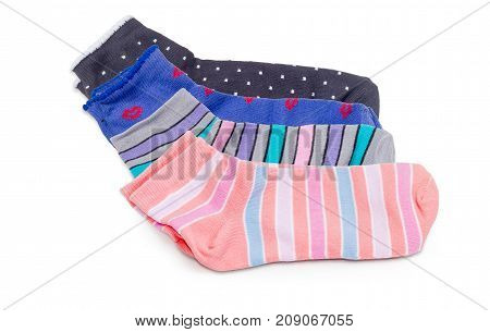 Several different pairs of the varicolored low cut women's everyday socks on a white background