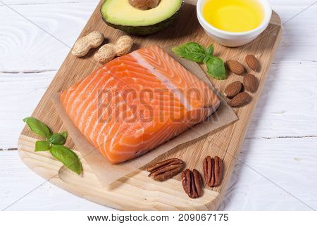Healthy food vegetables nuts and salmon . With vitamin omega 3