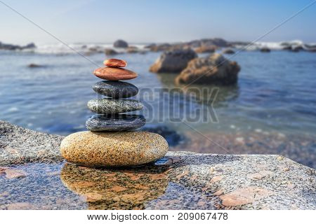 Pebbles Pyramid on ocean background, Harmony and Balance
