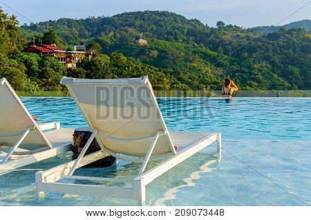 Luxury Swimming Pool With Sunbeds In Water At The Resort With Beautiful Landscape View