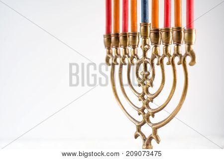 Brass hanukkah menorah with candles copy space horizontal