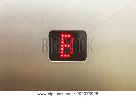 led panel on a brushed metal plate in an elevator that displays the letter B