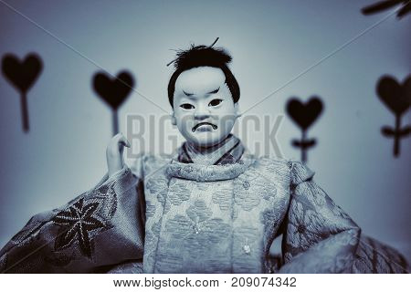 Japanese doll face fear in dark Background.