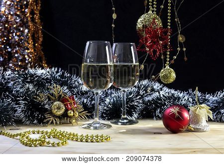 The Christmas and New Year still life with glasses of champagne on the table close-up