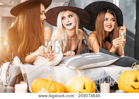 Group Of Creepy Friends At The Party Lying At Bed And Drink Champagne