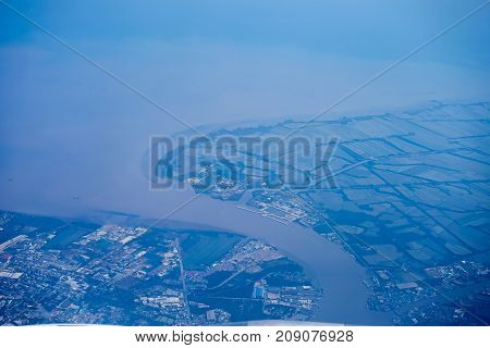 Aerial view over river the mouth with salt-field in Bangkok Thailand.