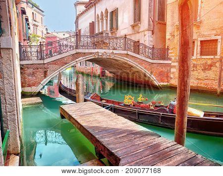 Lovely hidden venetian chanal with gondola in Venice, Italy