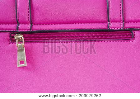 A photo of a pink faux leather with a zipper.