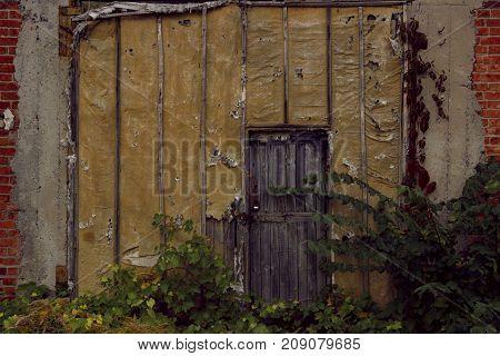 Old Door. Old Doors. Image of wooden door. Old House. Old Wooden Door On Brick Wall. Old Wooden Door.