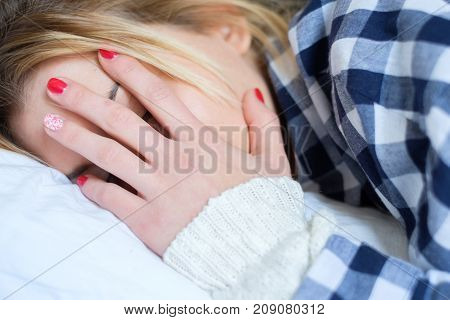 Young Woman Crying In Bed After Domestic Violence At Home