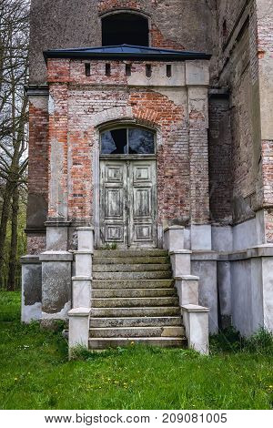 Desolate palace in small village Drezewo near Baltic Sea coast in Poland