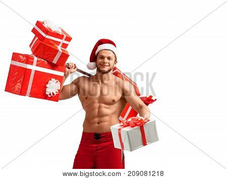 Bad Santa fantasies. Stunning shirtless ripped Santa Claus posing on a white background in studio copyplace on the side