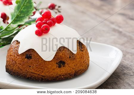 Christmas pudding on wooden table. Typical christmas sweet