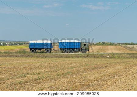 Old truck carrying soybeans in the fields