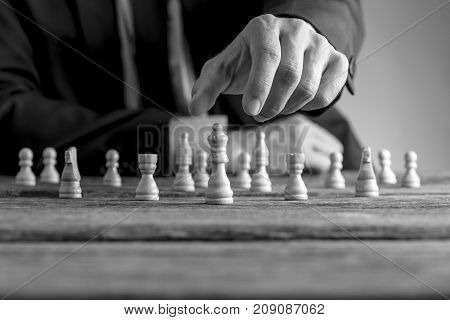 Monochrome Image Of A Businessman Wearing Suit Playing Chess