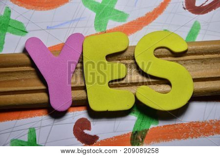 the word yes on a  abstract colorful background