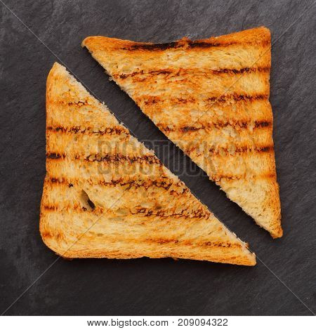 Pieces Of Grilled Bread Isolated. On The Black Background