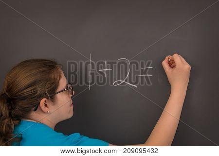 A teacher doing math on the chalkboard