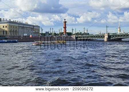 SAINT-PETERSBURG RUSSIA - JULY 20 2017: View from the water on the Kunstkamera Rostral column and the Peter and Paul Fortress in St. Petersburg