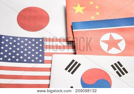 The flag of North Korea, South Korea, United Stated of America (USA), Japan and China made from paper.
