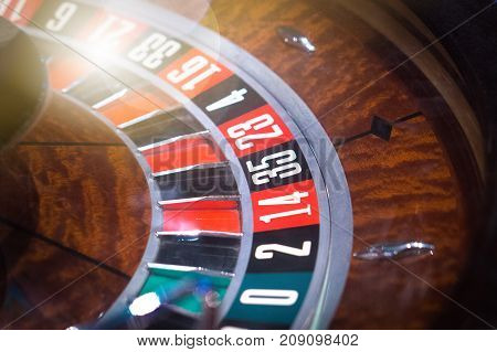 Luxury roulette in a casino with shiny light flare.