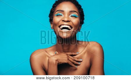 Cheerful Young Woman With Vibrant Makeup