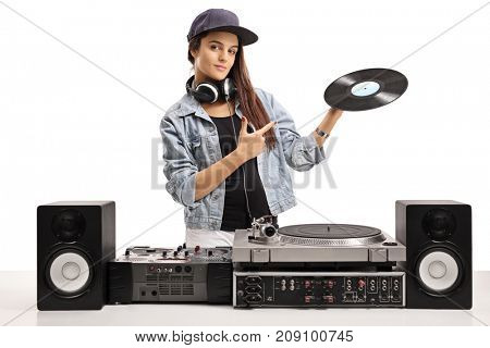 Female DJ holding a vinyl record and pointing isolated on white background