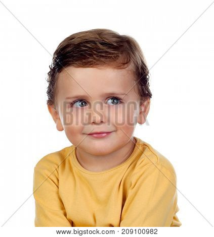 Adorable small child two years old with yellow t-shirt isolated on a white background