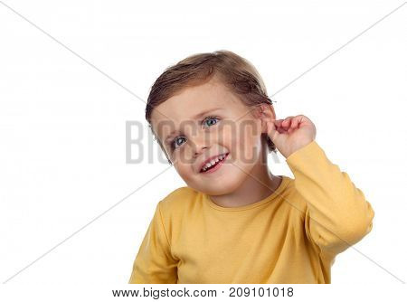 Adorable small child two years old touching his ear isolated on a white background