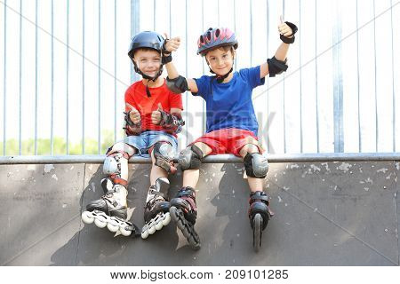 Cute boys on rollers at skate park