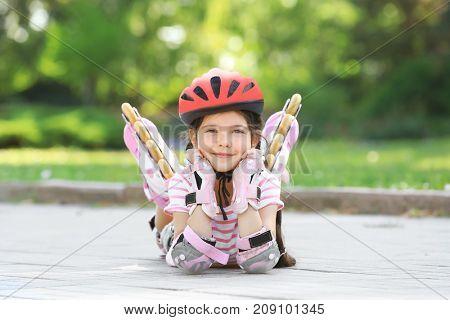Cute girl on roller skates in park