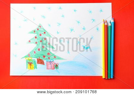 Child's drawing of Christmas tree with presents on red background