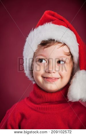 beauty boy in christmas hat.