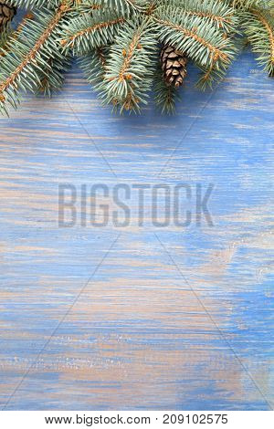 Christmas Tree on wooden background copy space for lettering.