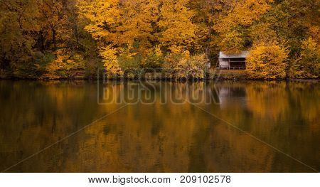 Beautiful lake and autumn forest .