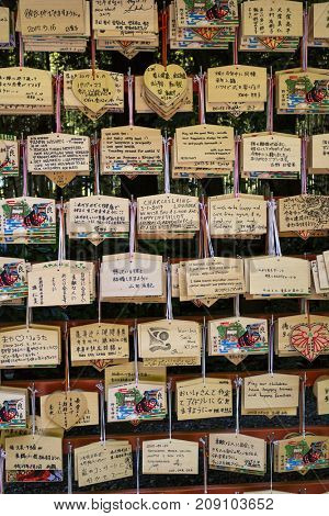 Kyoto, Japan - May 20, 2017:  Ema, small wooden votive plaques with wishes or prayers written on them in different languages