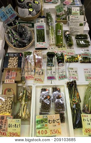 Kyoto, Japan -  May 22, 2017:  Selling variation of fresh raw packed vegetables at the Nishiki market in kyoto, Kyoto's Kitchen