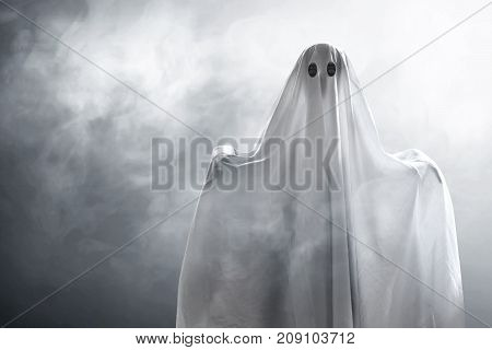 Mysterious ghost on smoke background at night