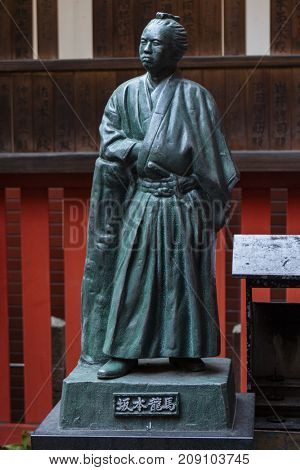 Kyoto, Japan - May 19, 2017: Stone statue of a traditional japanese samurai warrior