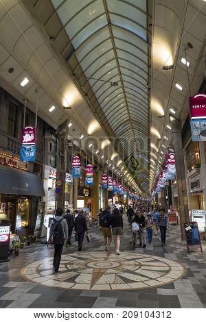 Kyoto, Japan - May 18, 2017: Pedestrians walking in the Shin Kyogoku Shopping Arcade
