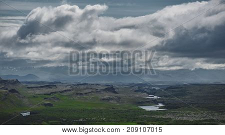 Travel to Iceland. beautiful mountain landscape in Iceland. Icelandic landscape with mountains, blue sky and green grass on the foreground.
