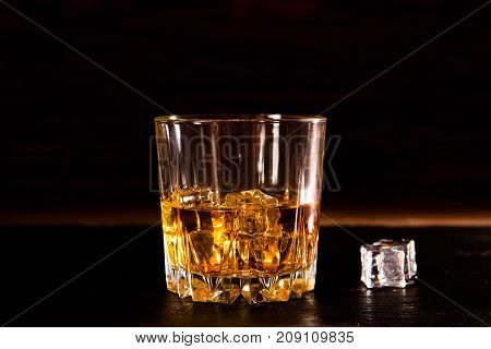 Whiskey Drink On Wooden Table Over Dark Background