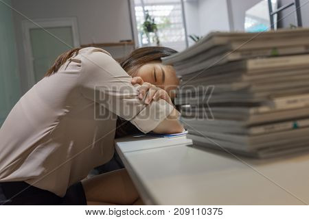 Tired office lady trying to take a nap in break-time