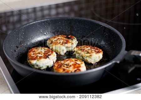 Meatballs are cooked on a hot frying pan