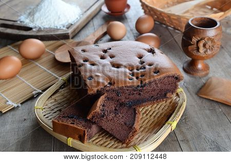 Taiwanese chocolate sponge cake with bamboo weave basket on wooden board