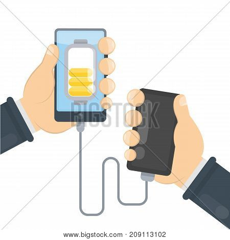 Charging phone with power bank. Hands holding devices.