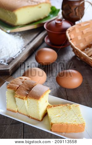 Taiwanese traditional sponge cake on white plate and wooden board