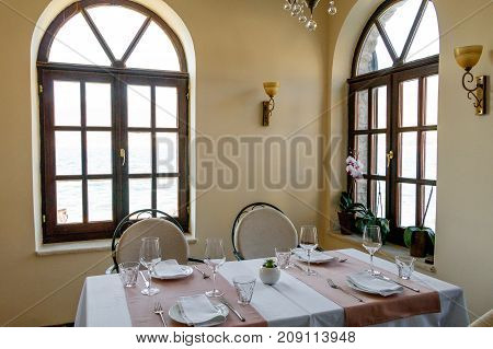 Interior of a Mediterranean restaurant Beautiful windows table setting