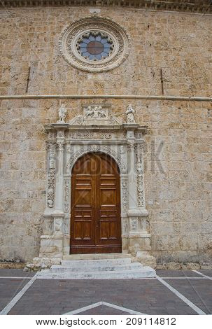 The entrance to the church door in Anversa degli Abruzzi decorated with stone sculptures